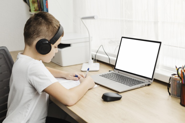 a boy attending an online class