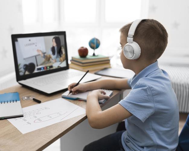 a boy attending online school