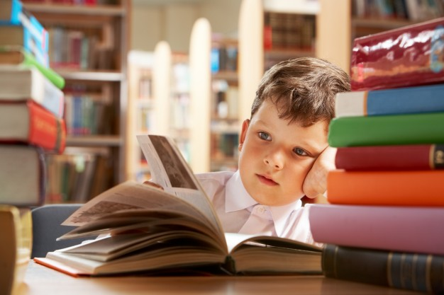 a child reading a book in a library