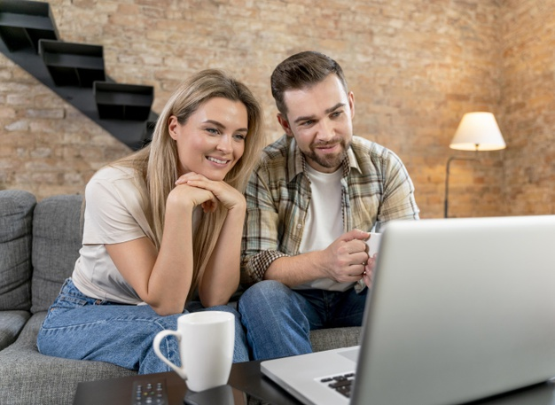 a couple consulting their friends for advice on reputable online schools