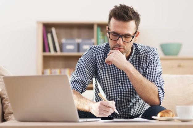 a father exploring Cambridge Home School's website