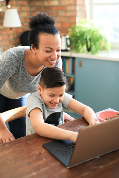 a mother checking in with her child during online school