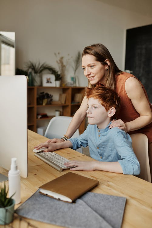 a mother setting up her son's online class