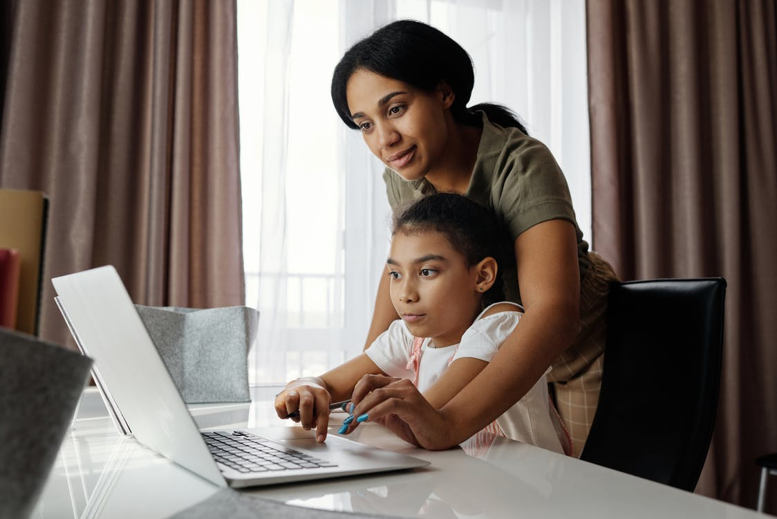 a parent analysing an online school's curriculum with her child