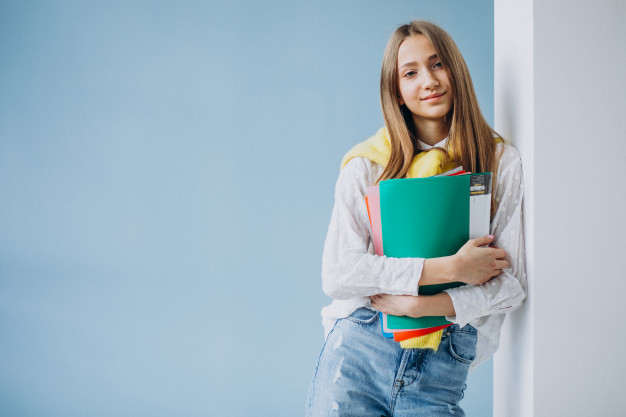 a student clutching study notes
