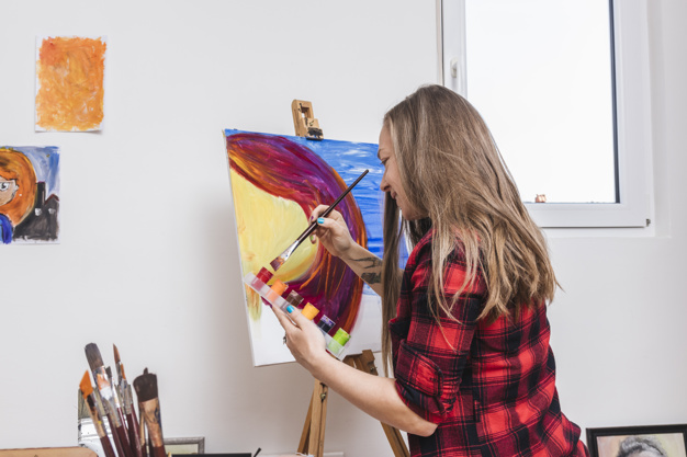 a student exploring her interest in painting