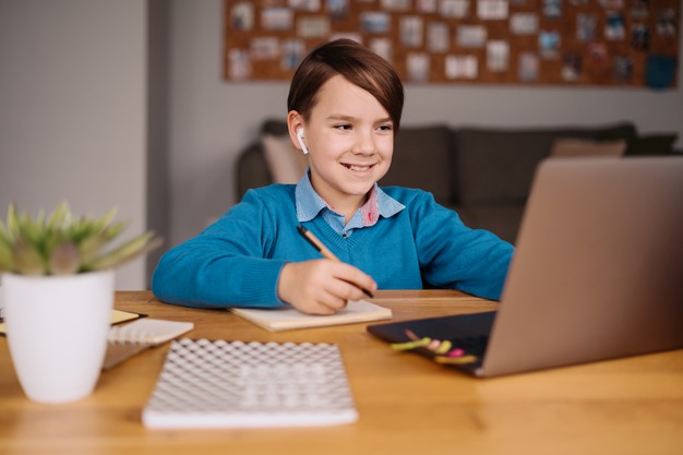 a student interacting with his peers as he attends online school