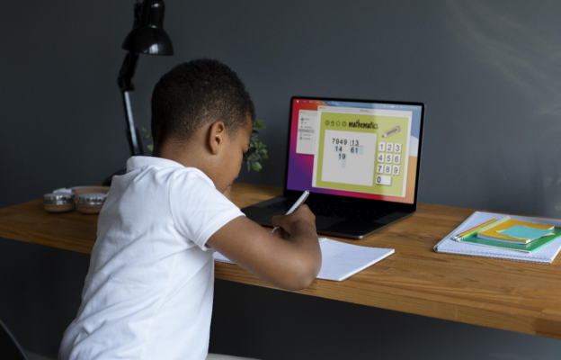 a student revising using Cambridge Home School's educational resources