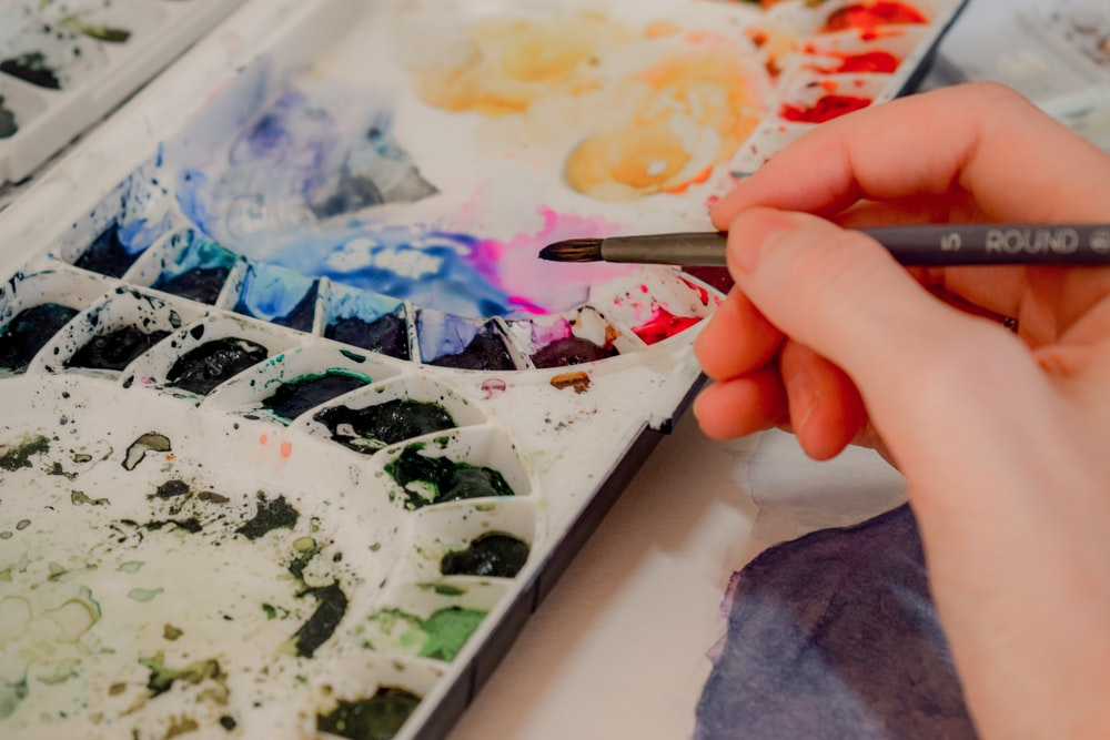 a student selecting a colour from a paint palette