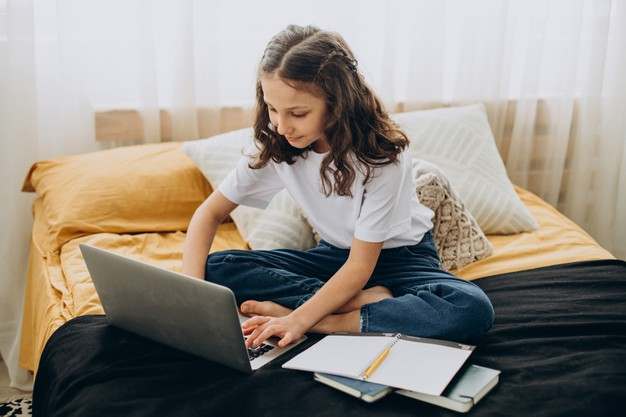 a young girl attending online primary school 1
