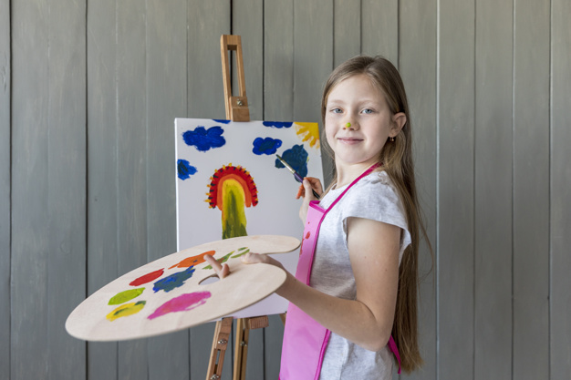 a young girl working on a painting project