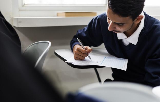 an IGCSE student sitting his Physics exam