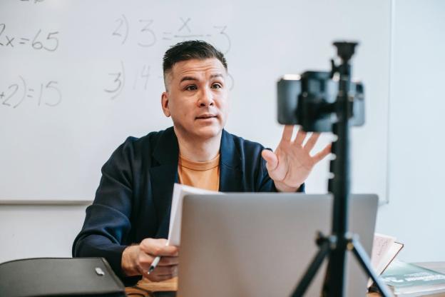 an empathetic teacher giving his students a pep talk 1