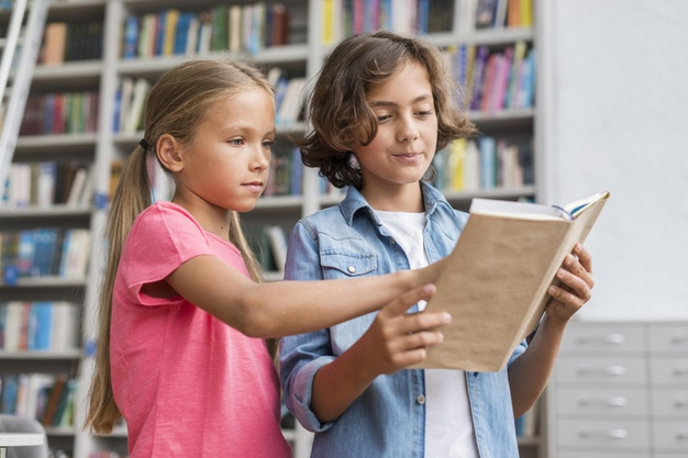 children analysing grammar rules in a SPAG book
