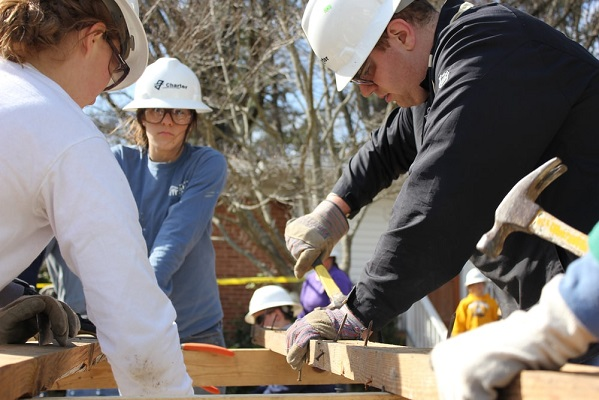 a teenage girl helping on a community construction project