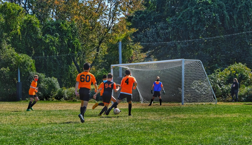 a group of teens playing soccer